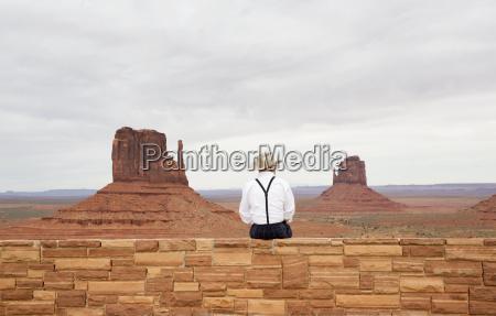 rear view of man wearing cowboy