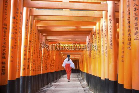 rear view of woman walking along