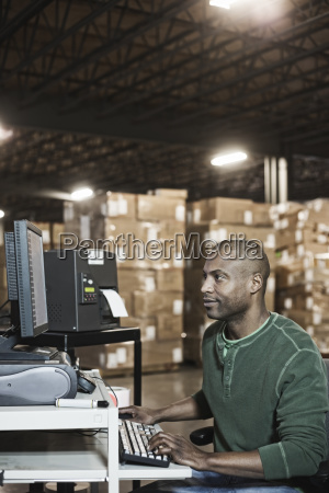 african american male warehouse worker working