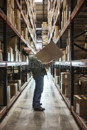 caucasian male warehouse worker standing in