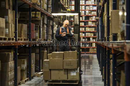 warehouse worker wearing a safety harness