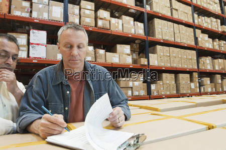 a male caucasian warehouse worker and