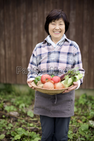 woman with black hair wearing checkered