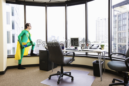 a caucasian man office super hero