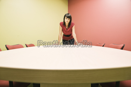 caucasian woman in a conference room
