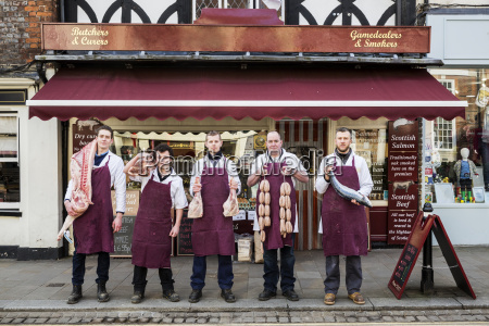 group of men butchers and fishmonger