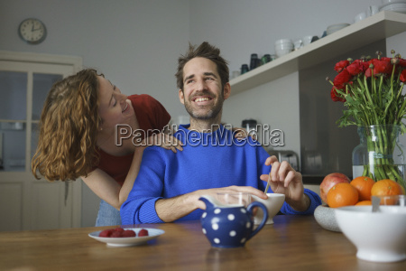 cheerful mid adult couple at table