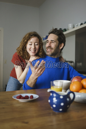 happy mid adult couple talking at