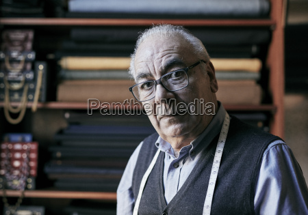 portrait of a senior tailor with