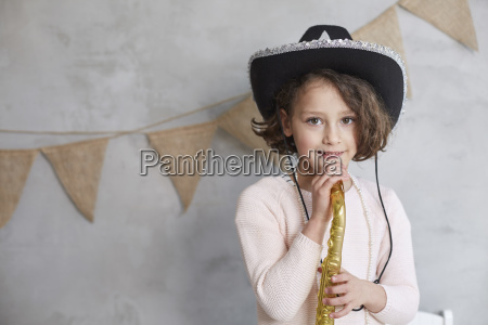 portrait of playful girl with prop