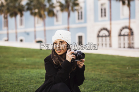 mid adult woman with camera looking