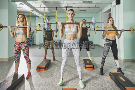 full length of female trainer with