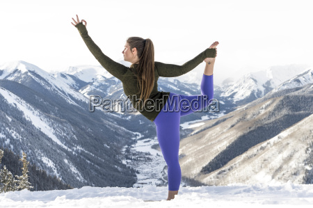 woman practicing yoga on top of