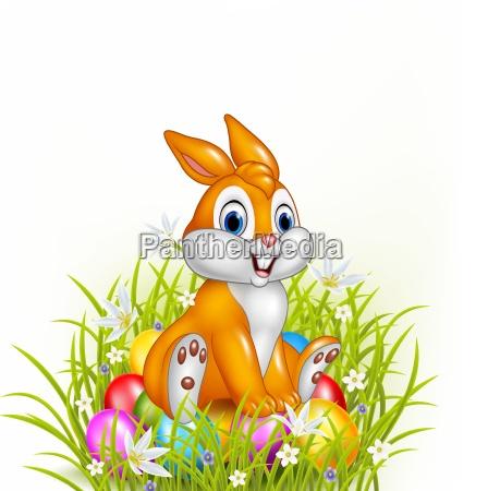 cartoon kaninchen sitzen auf ostereiern