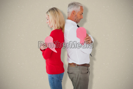 composite image of couple holding two