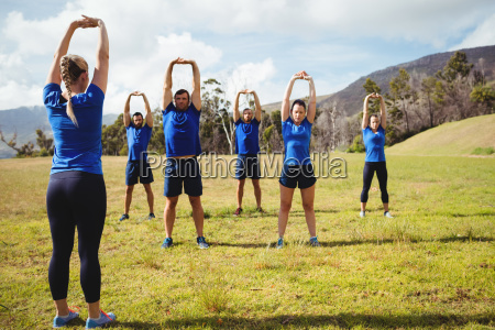 female trainer giving training to fit