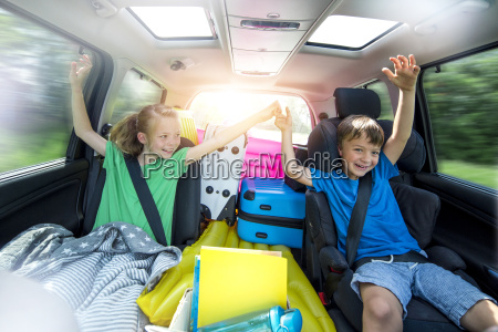 children relax in the car during
