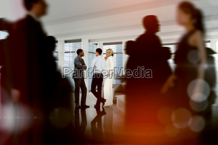 composite image of business people walking