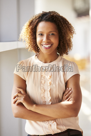 portrait of smiling young woman looking
