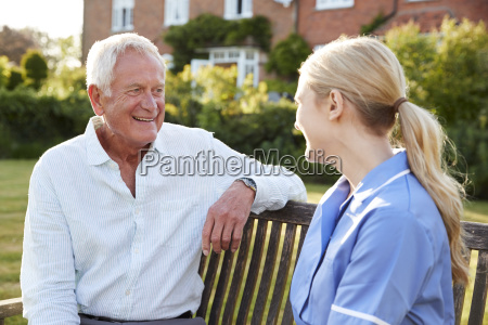 nurse talking to senior man in
