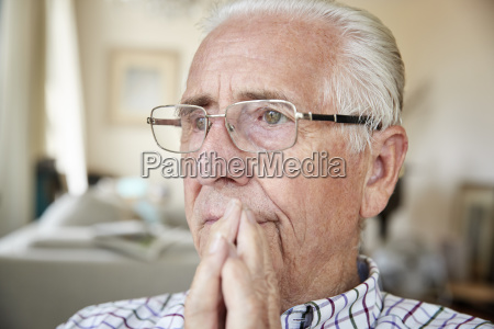 close up of contemplative senior man