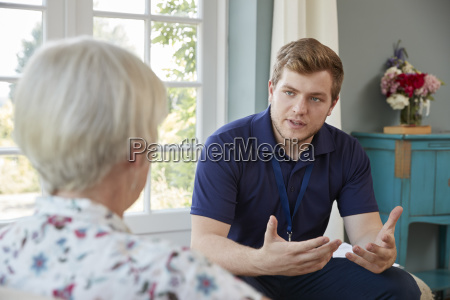 senior woman talking with male care