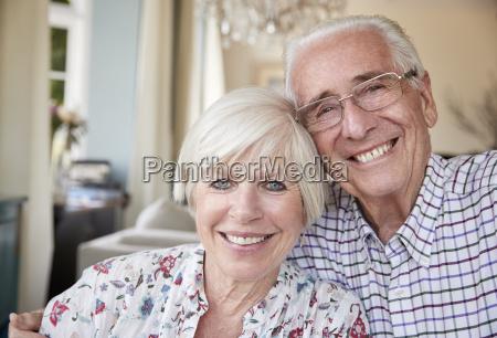 happy senior couple smiling to camera