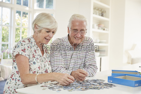 senior couple doing a jigsaw puzzle