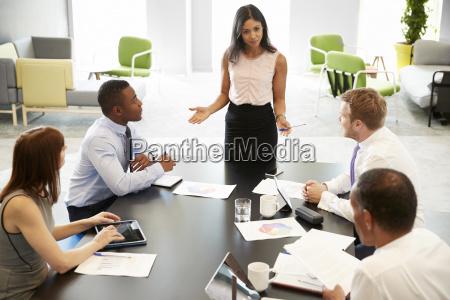 female boss gestures at informal work