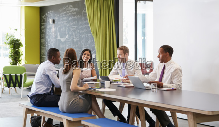 five business colleagues in an informal