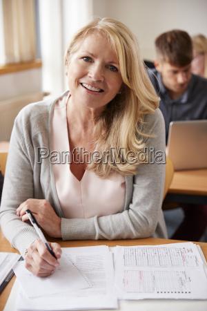 portrait of mature woman attending adult
