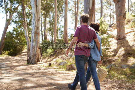 rear view of romantic couple hiking