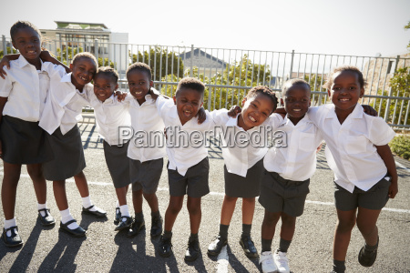 elementary school kids in africa posing