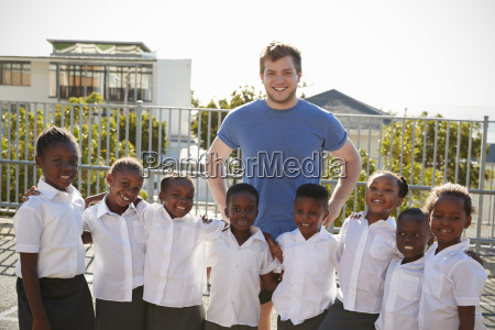 volunteer and elementary school kids in