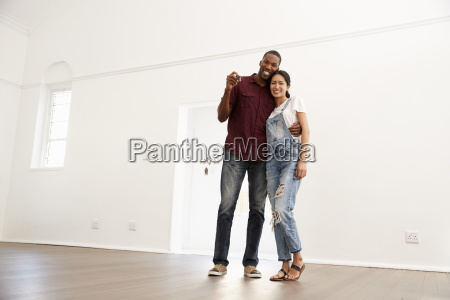 portrait of excited young couple moving