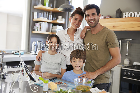 portrait of family in kitchen following