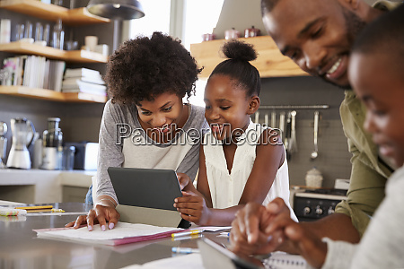 parents helping children with homework in