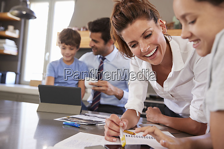 parents helping children with homework before