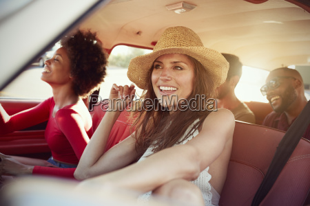 group of friends relaxing in car