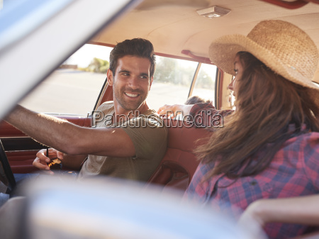 family relaxing in car during road