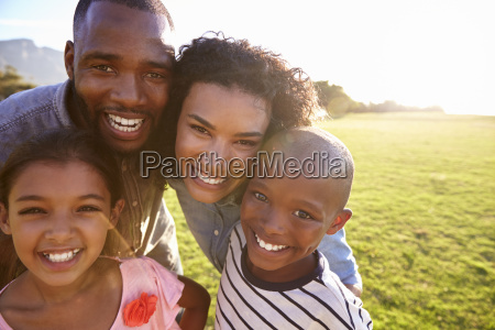 portrait of a smiling black family