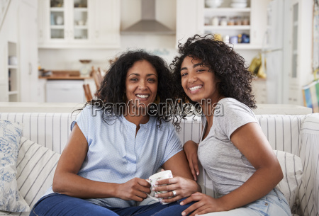 portrait of mother sitting with teenage