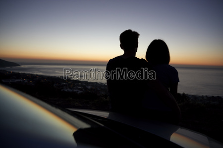 couple relaxing together by the sea