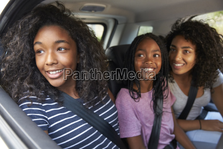 family with teenage children in car