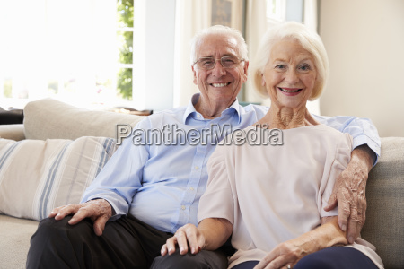 portrait of smiling senior couple sitting