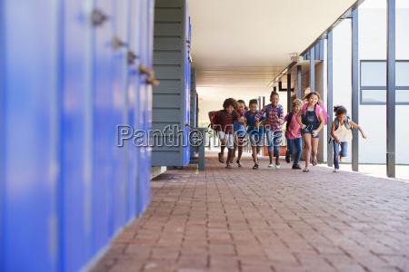 school kids running to camera in