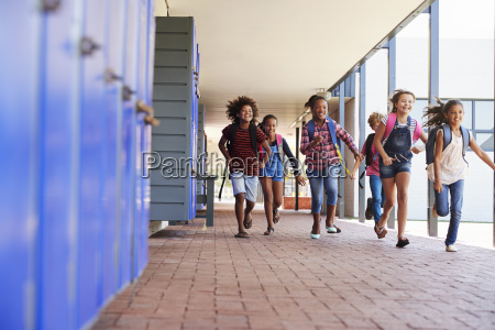 school kids running to camera in