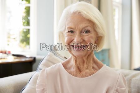 portrait of smiling senior woman sitting