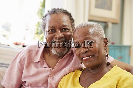 portrait of smiling senior couple sitting