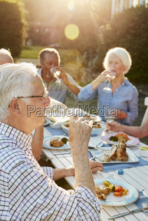 group of senior friends enjoying outdoor